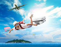 Young man flying from passenger plane to natural destination isl. And on blue ocean with happiness face use for people traveling on vacation holiday summer stock photos