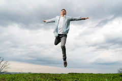 Young man flying in sky background Royalty Free Stock Images
