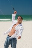 Young Man Flying a Stunt Kite Royalty Free Stock Photos