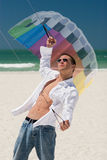 Young Man Flying a Stunt Kite. A young man working the control lines of a stunt kite on the public beach in Treasure Island, Florida Royalty Free Stock Photography