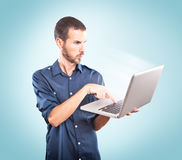 Young man focused holding a laptop Royalty Free Stock Images