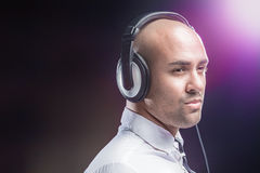 Young man focused on music Stock Image