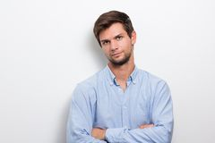Young man with folded arms looking serious Stock Photo
