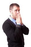Young man with folded hands near face Stock Image