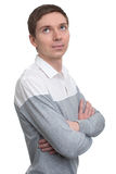 A young man with folded hands standing Stock Photo