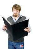 Young man with folder. A young man with large black folder stock photos