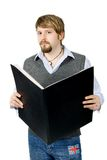 Young man with folder. A young man with large black folder royalty free stock images