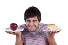 Young man food decision royalty free stock photography