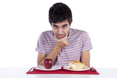 Young man food decision Stock Photography