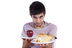 Young man food decision Stock Images