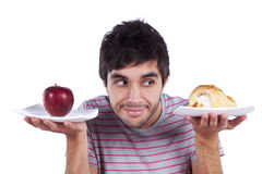 Young man food decision Stock Image