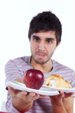 Young man food decision Stock Photo
