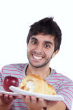 Young man food temptation Royalty Free Stock Photos