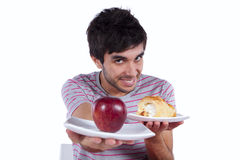 Young man food temptation Royalty Free Stock Image