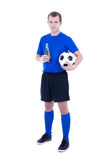 Young man in football form with ball and bottle of beer isolated Royalty Free Stock Images