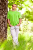 Young man in the forest Stock Photography
