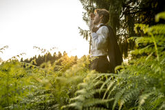 Young Man in the Forest Looking into the Distance Royalty Free Stock Images