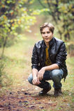 Young man in forest Royalty Free Stock Image