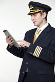 Young man in the form of a passenger plane pilot Royalty Free Stock Images