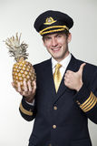 Young man in the form of a passenger plane pilot Royalty Free Stock Photos