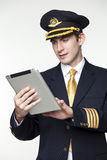Young man in the form of a passenger plane pilot Stock Photos