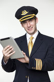 Young man in the form of a passenger plane pilot Royalty Free Stock Photography