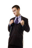 Young man in formal suit tear it apart because of Stock Photography