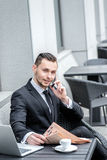 Young man in formal wear talking on the phone Royalty Free Stock Photo