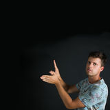 Young Man Forming Bird with Hand Gesture Royalty Free Stock Photography