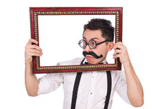Young man with frame isolated on white Royalty Free Stock Image