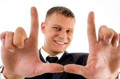 Young man framing his face with hand gesture Stock Photo
