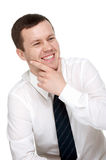 Young man with a friendly smile. Isolated background. Added stroke thickness of 1 pixel for easy selection Stock Photo