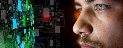 Young man in front of circuit board architecture - technology co stock photos
