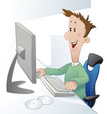 Young man in front of computer Royalty Free Stock Photography