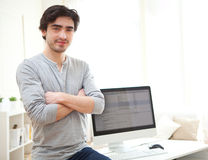 Young man in front of computer. View of a young man in front of computer Royalty Free Stock Images