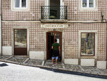 Young man in front of an old used book store in Lisbon. Royalty Free Stock Photo