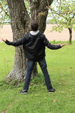 Young man in front of tree Stock Photos