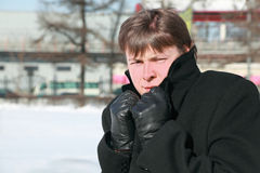 Young man froze in winter and hides head in collar Royalty Free Stock Photos