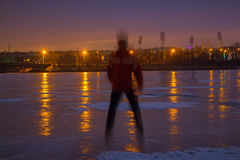 Young man on frozen river at night Royalty Free Stock Photos