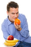 Young man with fruits healthy diet isolated Royalty Free Stock Images