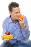 Young man with fruits healthy diet isolated Stock Image