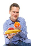 Young man with fruits healthy diet isolated Royalty Free Stock Photos