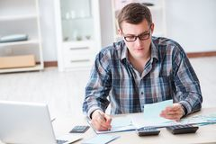 The young man frustrated at his house and tax bills. Young man frustrated at his house and tax bills Royalty Free Stock Photos