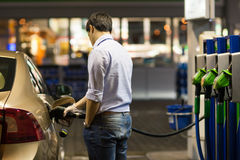 Young man fueling his car Stock Images
