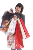 Young man full of Christmas gifts Stock Photo