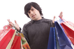 Young man full of Christmas gifts Royalty Free Stock Photo