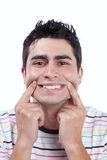 Young man with a funny face Stock Images
