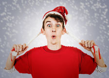 Young man in funny santa hat with pigtails Royalty Free Stock Photo