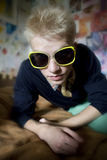 Young man in funny sunglasses Royalty Free Stock Photos