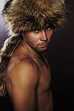 Young man in fur-cap. Portrait of  young man in  fur-cap Royalty Free Stock Photo